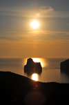 Porto Flavia, Masua, Sardinia / Sardegna / Sardigna: Sugar Loaf islet / Scoglio Pan di Zucchero at sunset - limestone stack on the Gonnesa gulf - photo by M.Torres