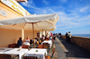 Alghero / L'Alguer, Sassari province, Sardinia / Sardegna / Sardigna: al fresco restaurant at Mirador d'Encamp, on the sea wall near Via Manno - La Muralla - photo by M.Torres