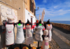 Alghero / L'Alguer, Sassari province, Sardinia / Sardegna / Sardigna: custom embroided aprons for sale - shop near St. Elmo bastion - La Muralla - photo by M.Torres