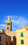 Alghero / L'Alguer, Sassari province, Sardinia / Sardegna / Sardigna: the tower of the Cathedral of Santa Maria rises above the houses of the historical centre - photo by M.Torres