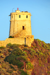 Pula, Cagliari province, Sardinia / Sardegna / Sardigna: Spanish tower of Sant´Efisio / Coltelazzo - lighthouse on Cape Pula - coastal tower built overlooking the ruins of Nora - Gulf of Cagliari - Sulcis-Iglesiente region - photo by M.Torres