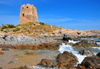 Bari Sardo, Ogliastra province, Sardinia / Sardegna / Sardigna: Torre di Bari - 17th century Aragonese defensive tower resists the waves of the Tyrrhenian Sea - in windy days this is a good beach for surfers - photo by M.Torres