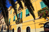 Cagliari, Sardinia / Sardegna / Sardigna: sunny façade under palm tree leaves - Via Santa Croce - quartiere Castello - photo by M.Torres