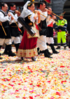 Cagliari, Sardinia / Sardegna / Sardigna: Feast of Sant'Efisio / Sagra di Sant'Efisio - pipers walk over rose petals playing launeddas - triplepipe - typical Sardinian woodwind instrument - paving stones covered in flowers of Via Roma - infiorata - photo by M.Torres