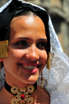 Cagliari, Sardinia / Sardegna / Sardigna: Feast of Sant'Efisio / Sagra di Sant'Efisio - beautiful Sardinian face - young woman in traditional attire from Selargius - photo by M.Torres