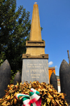 Tuili, Medio Campidano province, Sardinia / Sardegna / Sardigna: obelisk, crown of laurels and artillery shells - the Fatherland pays homage to the young men lost at war - square on Via Roma - photo by M.Torres