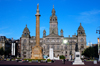 Scotland - Glasgow - George Squarein Glasgow - Robert Burns statue, nearest, the Sir Walter Scott column,and the City Chambers in the background with the sun reflecting in oneof its windows - photo by C.McEachern