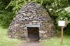 Scotland - Kilmartin: Recreation of a stone age beehive hut located next to Kilmartin House archaeological museum - photo by C. McEachern