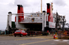 Scotland - isle of Islay - Port Ellen: the Calmac Ferry, stern to the wall, prepares to take on car and truck cargo - photo by C.McEachern