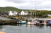 Scotland - Islay Island - Port Ellen: a view of part of the harbor with small boats moored to the wharf and the town in the background - photo by C.McEachern
