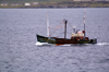 Scotland - Islay Island - Port Ellen - Inner Hebrides : a fishing vessel sets out to sea - photo by C.McEachern