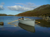 South Uist island / Uibhist a Deas, Outer Hebrides, Scotland: boat on Loch Snigisclett - photo by T.Trenchard