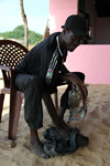 Cap Skirring, Oussouye, Basse Casamance (Ziguinchor), Senegal: Fisherman's restaurant, man showing the fresh fish, everyday life / Restaurante de um pescador, pescador mostrando o peixe fresco, vida quotidiana - photo by R.V.Lopes