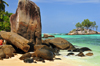 Mahe, Seychelles: Anse Royal - ile Souris and large rocks - photo by M.Torres