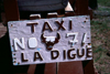 Seychelles - La Digue island: bovine taxi - license plate - photo by F.Rigaud