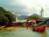 Tumbu, Western Area, Sierra Leone: colourful boat in the harbour - mosque in the background - photo by T.Trenchard