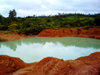 Kono district,  Eastern Province, Sierra Leone: diamond mine - pond on a crater - photo by T.Trenchard