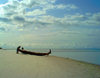 Turtle Islands, Southern Province, Sierra Leone: fishermen and small fishing canoe on the beach - photo by T.Trenchard