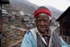 Sikkim: yak a man and his village - mountain dweller - photo by G.Koelman