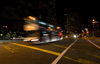 Singapore: bus on an intersection - nocturnal - photo by P.Jolivet