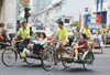 Singapore: tourists in trishaws (photo by S.Lovegrove / Picture Tasmania)