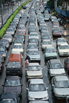 Singapore: cars - traffic jam - six lanes become five - photo by S.Lovegrove