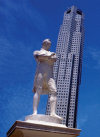 Singapore: Statue of Sir Stamford Raffles and OUB Plaza One - photo by B.Henry
