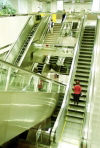Singapore: Commuters navigate escalators at one of the Mass Rapid Transit (MRT) stations (photo by R.Eime)