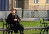 Slovakia / Slowakei - Bratislava: old man on a bench - photo by J.Kaman