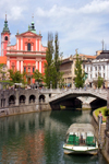 View across Ljubljanica / Laibach river to Preseren square - Triple bridge, Franciscan church and the Central Pharmacy, Ljubljana, Slovenia - photo by I.Middleton