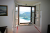 Slovenia - window - view across Lake Bled to island church from inside castle - photo by I.Middleton