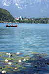 Slovenia - People rowing across Lake Bled - photo by I.Middleton