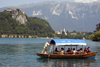 Slovenia - Pletna rowing tourists on lake Bled - photo by I.Middleton