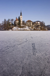 Slovenia - tracks on the ice - frozen lake Bled and the island church of the Assumption of Mary - Cerkev Marijinega vnebovzetja - photo by I.Middleton