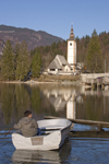 Slovenia - Ribcev Laz - boat and church - Bohinj Lake in Spring - photo by I.Middleton