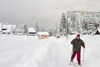 Slovenia - Man cross country skiing in the village Ribcev Laz near Bohinj Lake - photo by I.Middleton