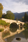 Slovenia - Ribcev Laz - stone bridge reflected on Bohinj Lake - photo by I.Middleton