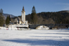 Slovenia - Ribcev Laz - People walking and ice skating on Bohinj Lake when frozen over - Church of St John the Baptist and stone bridge - photo by I.Middleton