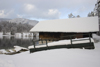 Slovenia - Ribcev Laz - bungalow and view across Bohinj Lake in winter - photo by I.Middleton