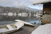 Slovenia - Ribcev Laz - frozen boat - view across Bohinj Lake in winter - photo by I.Middleton