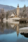 Slovenia - Ribcev Laz - St John's church - view across Bohinj Lake in winter - photo by I.Middleton