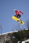 Slovenia - Snowboarder on Vogel mountain in Bohinj - jump with lemon board - photo by I.Middleton