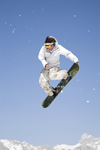 Slovenia - Snowboarder on Vogel mountain in Bohinj - flying - photo by I.Middleton