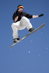 Slovenia - Snowboarder on Vogel mountain in Bohinj - flying and posing - photo by I.Middleton