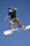 Slovenia - Snowboarder on Vogel mountain in Bohinj - jumper and sky - photo by I.Middleton