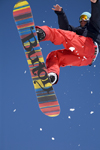 Slovenia - Snowboarder on Vogel mountain in Bohinj - rainbow board - photo by I.Middleton