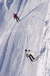 Slovenia - skiers speed down Vogel mountain in Bohinj - photo by I.Middleton