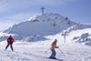 Slovenia - hill with cross and people skiing on Vogel mountain in Bohinj - photo by I.Middleton