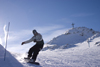 Slovenia - hill with cross and snowboarder on Vogel mountain in Bohinj - photo by I.Middleton