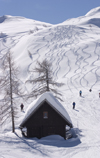 Slovenia - Mountain Hut and people skiing on Vogel mountain in Bohinj - photo by I.Middleton